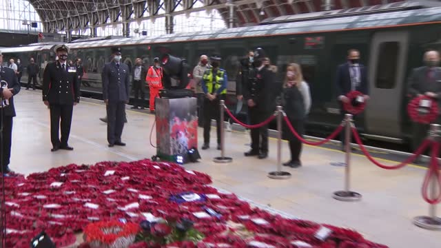 paddington station gvs; england: london: paddington station: int various shots police officer and station staff laying wreaths at foot of statue - armistice stock videos & royalty-free footage