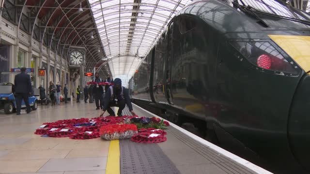 paddington station gvs; england: london: paddington station: int gvs train at platform and trains pulling into station and 'harry billinge mbe ldh'... - armistice stock videos & royalty-free footage