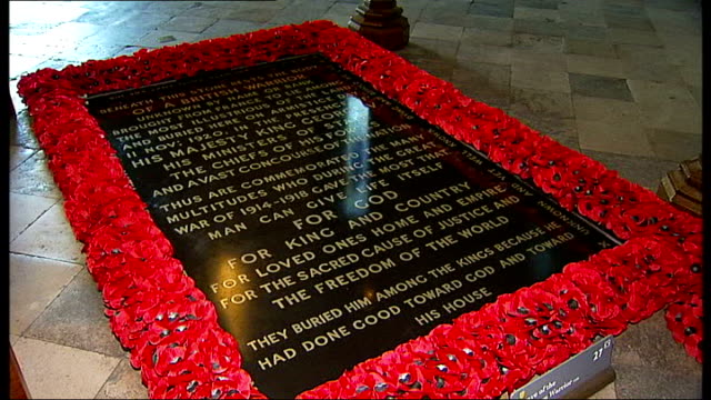 stockvideo's en b-roll-footage met gvs tomb and exterior of westminster abbey england london westminster abbey int gvs of tomb of the unknown warrior surrounded by red poppies /... - westminster abbey