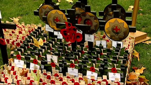 prince philip visit to westminster abbey; england: london: westminster abbey: int gvs tomb of the unknown warrior surrounded by poppies ext gvs cross... - tomb of the unknown warrior westminster abbey stock videos & royalty-free footage