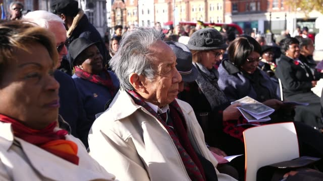 Tributes paid to AfricanCaribbean soldiers in Brixton ENGLAND London Brixton Windrush Square EXT **Music heard** Alvin ChyQuene listening to music at...