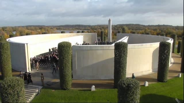 falls silent to honour war dead: national memorial arboretum service:; england: staffordshire: national memorial arboretum: ext people gathering for... - national memorial arboretum stock videos & royalty-free footage
