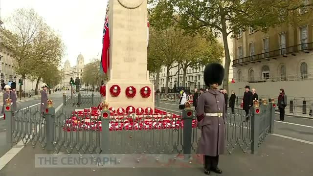 marks socially distanced armistice day amid covid-19 pandemic; england: london: westminster: whitehall: the cenotaph: ext gv soldier standing to... - armistice stock videos & royalty-free footage