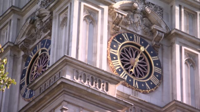 westminster cathedral bells ringing; england: london: westminster: ext gvs westminster cathedral as bells ringing sot gvs clock face / union jack... - westminster cathedral stock videos & royalty-free footage