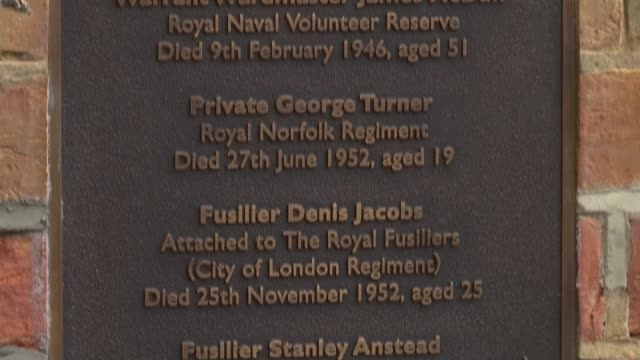 armistice day woolwich memorial plaque unveiled fusilier lee rigby amongst those honoured close shot of st george's chapel memorial plaque honouring... - ウールウィッチ点の映像素材/bロール