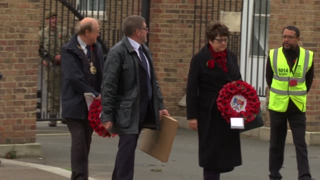 armistice day: woolwich memorial plaque unveiled: fusilier lee rigby amongst those honoured; union jack flag flying from flagpole close shot of order... - 飾り板点の映像素材/bロール
