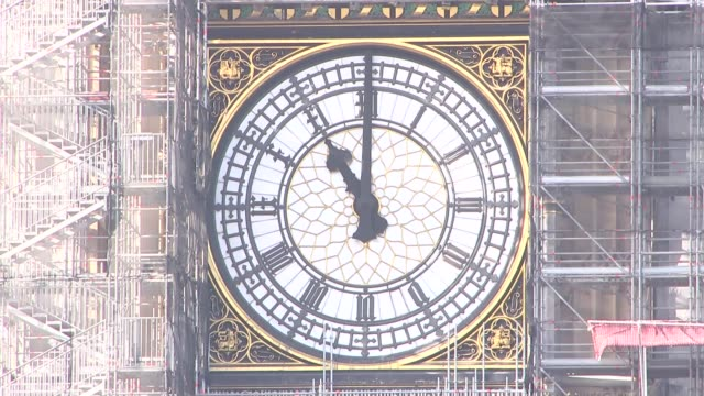 WWI Centenary marked at services at Cenotaph and across world ENGLAND London Westminster Long shot Big Ben clock face with scaffolding chiming at...