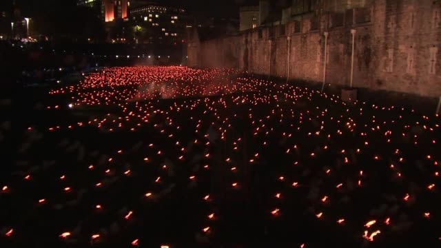 WWI Centenary marked at services at Cenotaph and across world ENGLAND London Tower of London Yeoman Warder standing as candles burn in installation...