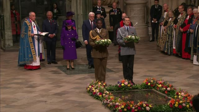 stockvideo's en b-roll-footage met centenary marked at services at cenotaph and across world; england: london: westminster: westminster abbey: int wreaths laid on behalf of queen... - westminster abbey