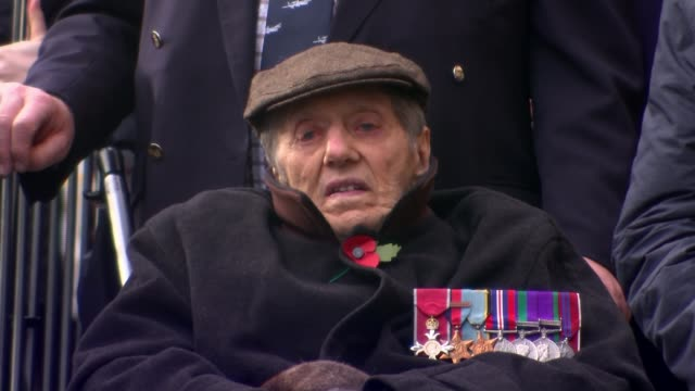 WWI Centenary marked at services at Cenotaph and across world ENGLAND London Westminster EXT Soldier in wheelchair wearing medals Big Ben clock face...