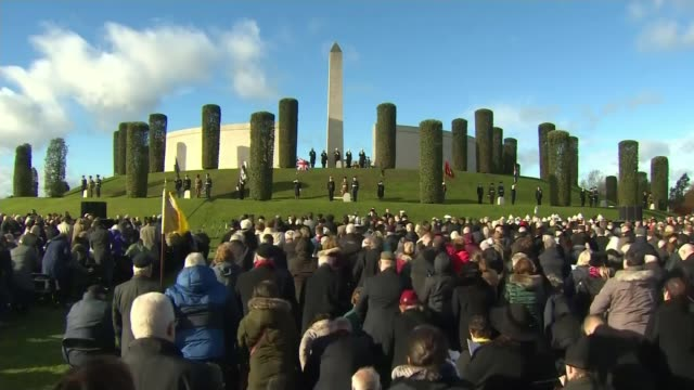 WWI Centenary marked at services at Cenotaph and across world ENGLAND Staffordshire Alrewas National Memorial Arboretum EXT Crowds standing at...