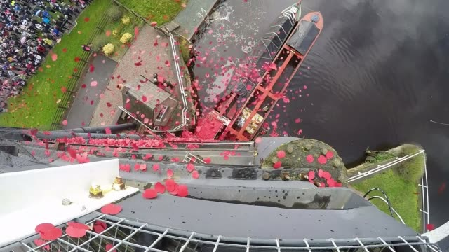 WWI Centenary marked at services at Cenotaph and across world UK Cheshire Northwich Anderton Boat Lift Poppy petals released into River Weaver for...