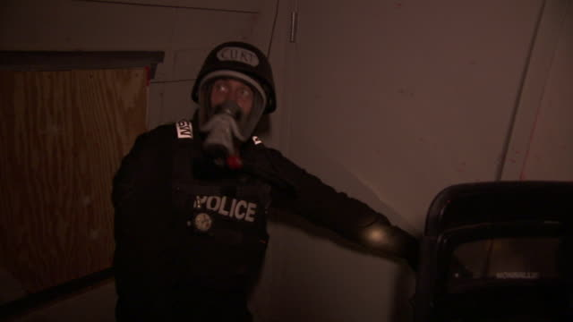 armored officers search a room during raid training. - military training stock videos & royalty-free footage
