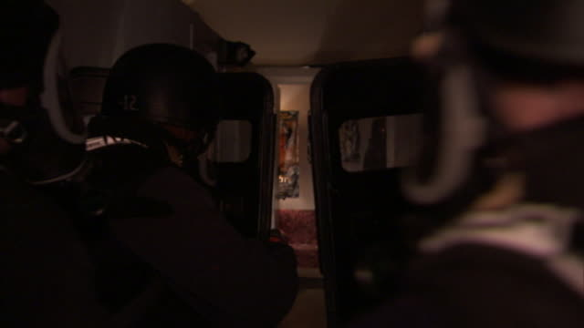 armored offices enter a room during a raid exercise. - military training stock videos & royalty-free footage