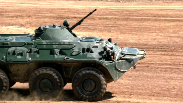 armored personnel carrier at full speed - military land vehicle stock videos & royalty-free footage