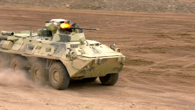 armored personnel carrier firing a machine gun while driving - machine gun stock videos & royalty-free footage