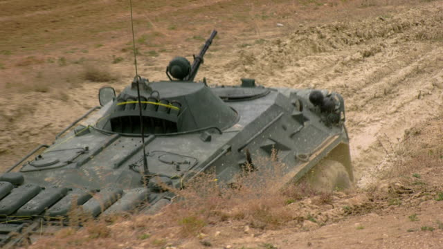 armored personnel carrier on an obstacle course overcomes a ditch - machine gun stock videos & royalty-free footage