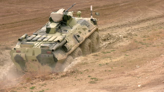 armored personnel carrier overcomes a deep ditch - machine gun stock videos & royalty-free footage