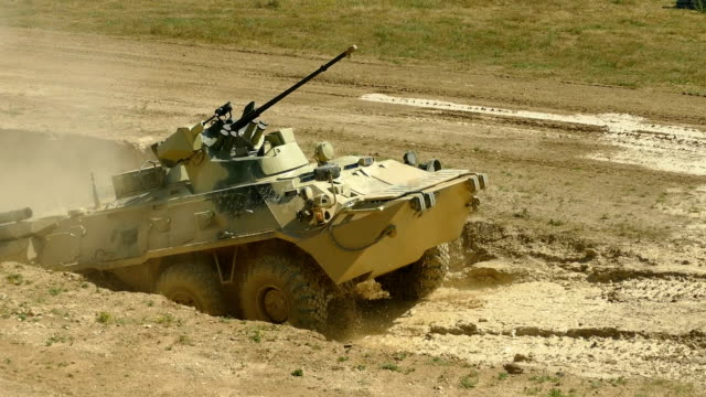 armored personnel carrier overcomes a water barrier - russia stock videos & royalty-free footage
