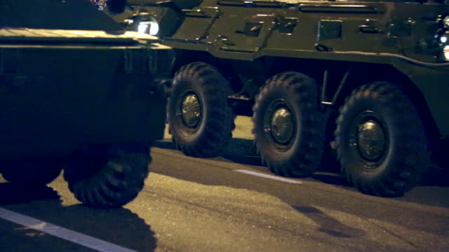 armored personnel carriers on city streets - armoured vehicle stock videos and b-roll footage