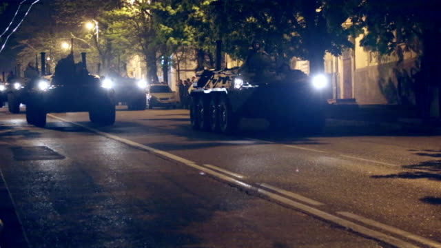 armored personnel carriers on the night streets - military land vehicle stock videos & royalty-free footage