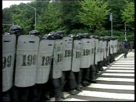 armored police march forward in column during student rally in seoul south korea 15 aug 94 - in a row stock videos & royalty-free footage