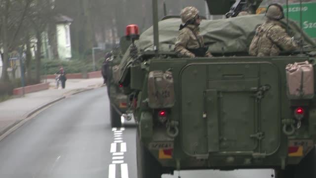 armored transport convoy - segnale informativo video stock e b–roll