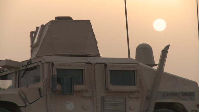 armored u.s. marine humvees are parked on a dirt hillside. - afghanistan stock videos & royalty-free footage