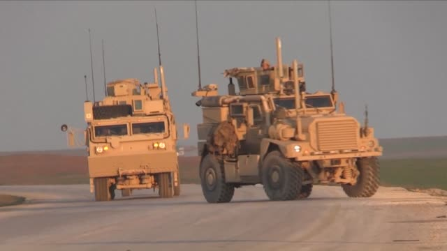 us armored vehicles patrol with the syrian democratic forces in north eastern syria after us decision to pull troops out of eastern syria leave kurds... - syrian democratic forces stock videos & royalty-free footage