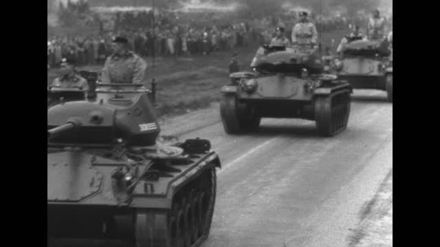 stockvideo's en b-roll-footage met armored vehicles roll past reviewing stand holding queen juliana and prince bernhard during operation crescendo military review / vs tanks roll along... - documentairebeeld