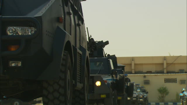 armored vehicles travel in single file. - weaponry stock videos & royalty-free footage