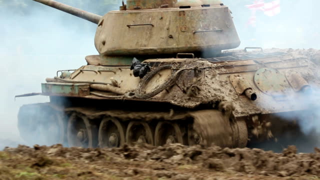 armoured army tank driving - armoured vehicle stock videos and b-roll footage