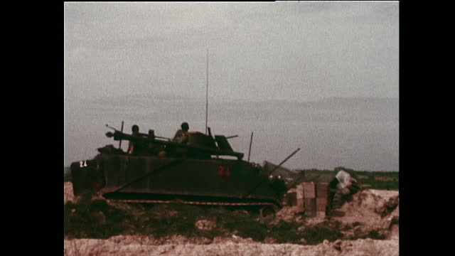 armoured military vehicles, stationed around my thanh village, fire on an unseen enemy during the vietnam war; 1972. - non us film location stock videos & royalty-free footage