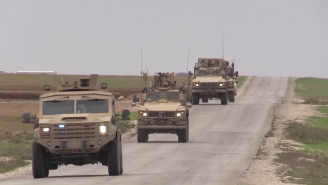 armoured vehicles carrying us forces arrive in the kurdish held northeastern town of al darbasiyah bordering with turkey as they patrol the area with... - syrian democratic forces stock videos & royalty-free footage