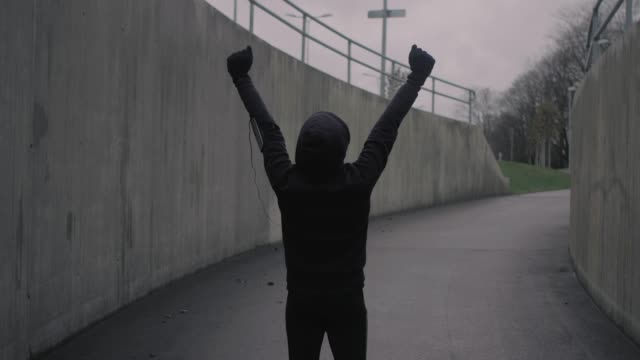 Arms raised after run (slow motion)