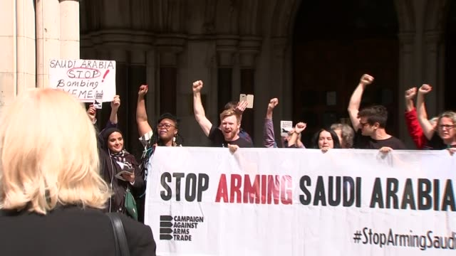 arms sales to saudi arabia declared 'unlawful'; england: london: royal courts of justice: ext protesters cheering as holding 'stop arming saudi... - sale stock videos & royalty-free footage