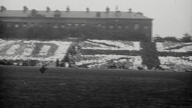1925 pan armstrong college stadium with large crowd rising in sequence revealing the words good luck with the union flag in the center / newcastle upon tyne, england, united kingdom - 1925 stock videos & royalty-free footage