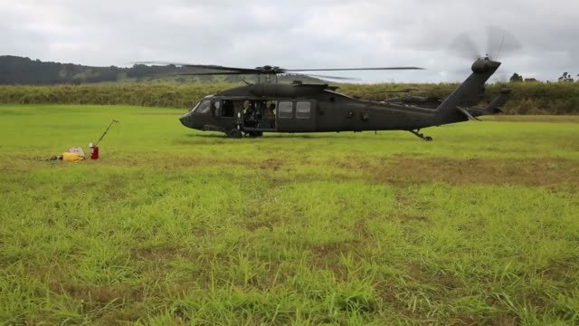 us army 25th combat aviation brigade conduct gunnery qualification at schofield barracks hawaii with uh60 black hawk and ah64 apache helicopters... - black hawk helicopter stock videos and b-roll footage