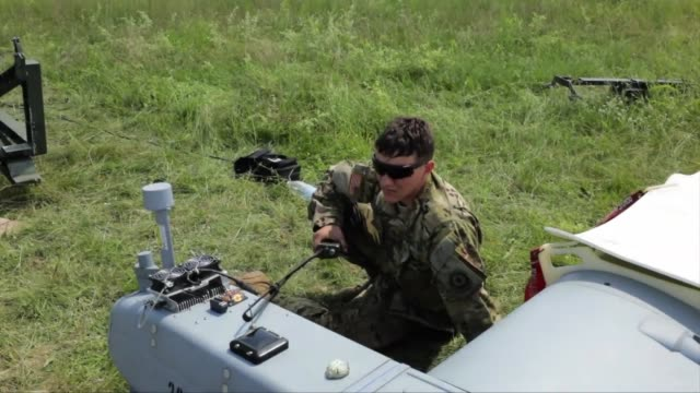 army 2nd cavalry regiment prepare the rq-7 shadow unmanned aerial vehicle for flight while on exercise in poland. - unmanned aerial vehicle stock videos & royalty-free footage