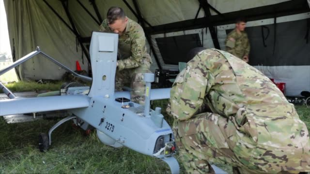 us army 2nd cavalry regiment prepare the rq7 shadow unmanned aerial vehicle for flight while on exercise in poland - 無人航空機点の映像素材/bロール