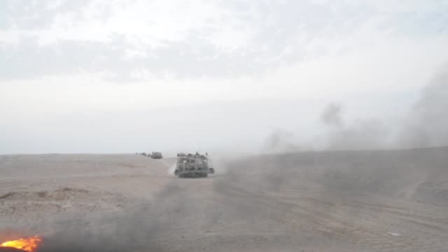 US Army 3rd Armored Brigade Combat Team 1st Cavalry Division training with tanks and armored personnel carriers in desert in United Arab Emirates
