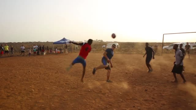US Army 407th Civil Affairs Battalion 1141st Task Force Alamo and the 870th Air Expeditionary Squadron play a game of soccer with a local village...