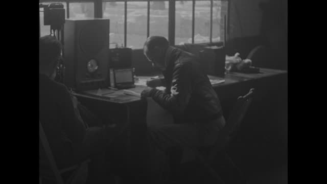 us army air corps officer and radio operator sitting at desk at airfield / note exact day not known - radio stock videos & royalty-free footage