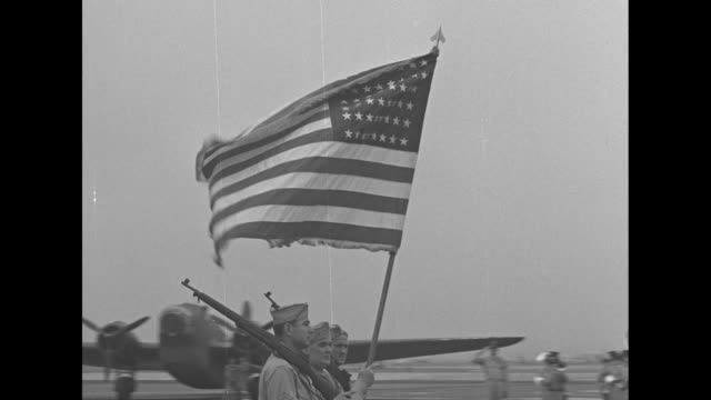 stockvideo's en b-roll-footage met us army air forces color guard walks on tarmac of airfield at bolling field during medals ceremony for members of the doolittle raid / lt gen jimmy... - geallieerde mogendheden