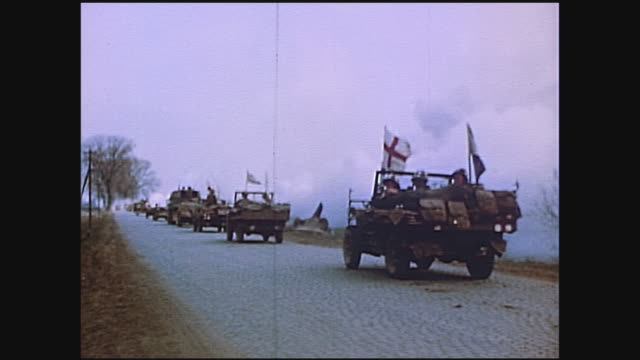 army ambulances and medical jeeps all flying red cross flags traveling along road during wwii european campaign / germany - all european flags stock videos and b-roll footage
