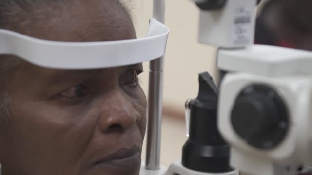 us army and and air force ophthalmologists and medical personnel screen patients in preparation for cataract surgery in support of exercise new... - ophthalmologist stock videos and b-roll footage