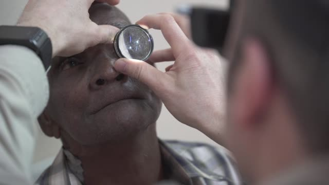 us army and and air force ophthalmologists and medical personnel screen patients in preparation for cataract surgery in support of exercise new... - eyesight stock videos & royalty-free footage