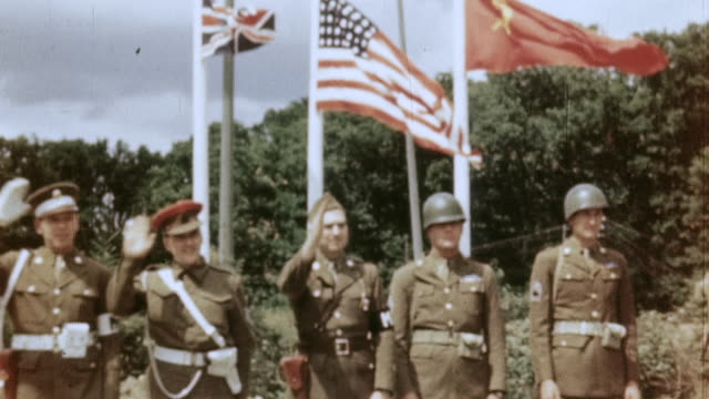 s army and british army soldiers saluting in front of allied flags on vertical poles / germany - former ussr flag stock videos & royalty-free footage