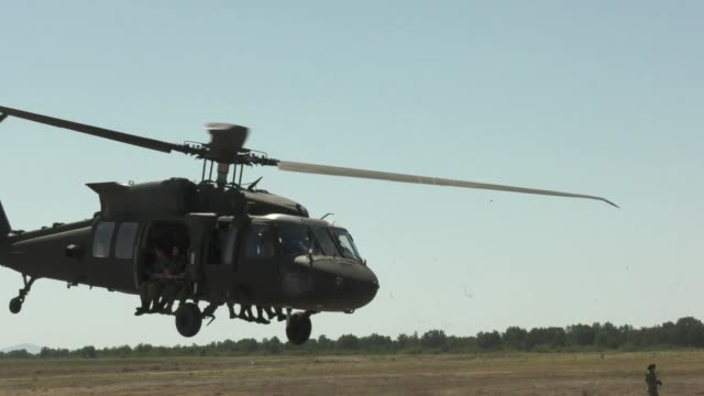 us army and bulgarian special forces soldiers conduct static line parachute training from an uh60 black hawk helicopter at plovidiv bulgaria 20... - military helicopter stock videos & royalty-free footage