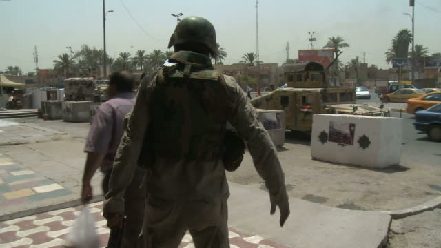 s army and iraqi soldiers patrolling streets and market area / baghdad iraq - 2010 video stock e b–roll